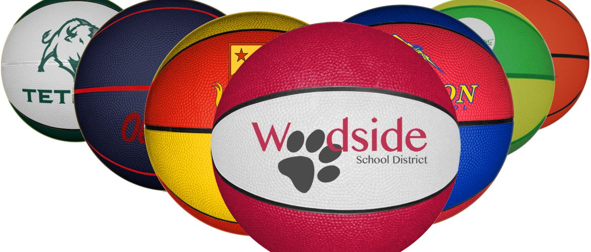 Personalized rubber basketballs with permanent logo printed onto each ball.